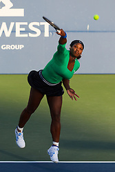 July 26, 2011; Stanford, CA, USA;  Serena Williams (USA) serves the ball against Anastasia Rodionova (AUS), not pictured, during the first round of the Bank of the West Classic women's tennis tournament at the Taube Family Tennis Stadium.