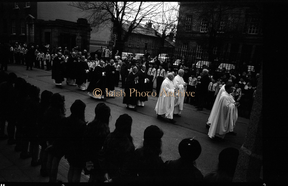 Archbishop Ryan Installed as Archbishop of Dublin..1972..27.02.1972..02.27.1972..27th February 1972..The installation of the Most Rev Dr Dermot Ryan as Archbishop of Dublin took place in The pro Cathedral,Dublin on Sunday 27th Feb 1972..Image of members of the Irish clergy as they proceed towards the Pro Cathedral for the installation of Dr Ryan as Archbishop. A guard of honour was provided by the Irish Girl Guides and The Irish Boy Scout associations.