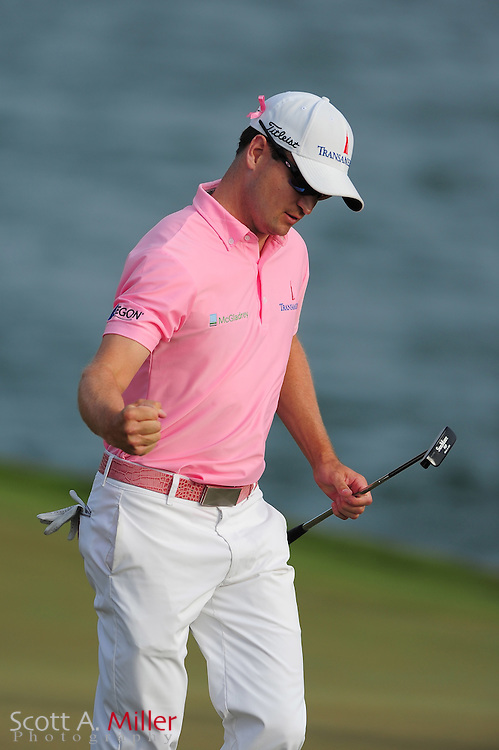 Zach Johnson celebrates his par putt on the 18th fairway during the final round of the Players Championship at the TPC Sawgrass on May 13, 2012 in Ponte Vedra, Fla. ..©2012 Scott A. Miller..