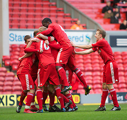 LIVERPOOL, ENGLAND - Saturday, January 8th, 2011: Liverpool players mob goalscorer Kristjan Emilsson after his equalising goal against Crystal Palace during the FA Youth Cup match at Anfield. (Photo by David Tickle/Propaganda)