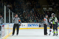 KELOWNA, CANADA -FEBRUARY 7: Referees Chris Schlenker and Fraser Lawrence speak to the goal judge after a breakaway from Ryan Olsen is reviewed against the Edmonton Oil Kings on February 7, 2014 at Prospera Place in Kelowna, British Columbia, Canada.   (Photo by Marissa Baecker/Getty Images)  *** Local Caption *** Chris Schlenker;