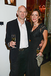 "ADRIAN NEWEY chief technical officer of the Red Bull Racing Formula One team and AMANDA SMERCZAK at an ""Evening With Damon Hill'  a dinner and talk in aid of the Downs Syndrome Association held at Claridge's, Brook Street, London on 7th November 2013."
