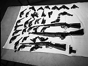 Arms handed to Gardai after Amnesty..1972..04.08.1972..08.04.1972..4th August 1972..After announcing an amnesty to all those who turned in unlicensed weapons, the Garda Siochana displayed some of the weapons which were handed in. The display of weapons was held at Garda Headquarters in Phoenix Park,Dublin. The display shows only the various handguns and rifles handed in but there was also a large selection of knives and bayonets etc (not shown here) handed in .