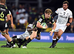 Hurricanes Jordie Barrett is tackled by Sharks Lubabalo Mtembu in the Super Rugby match at McLean Park, Napier, New Zealand, Friday, April 06, 2018. Credit:SNPA / Ross Setford