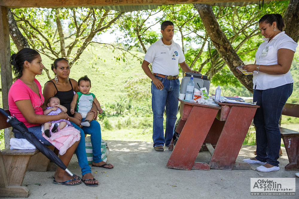 Women wait to have their children vaccinated at the primary school in the town of Coyolito, Honduras on Wednesday April 24, 2013.