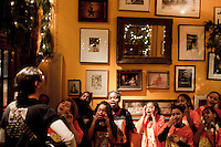 "18 December, 2008. New York, NY. Choir director Gregg Breinberg, 36, directs his fifth grade students from the Graniteville School chorus in Staten Island, at the Kitchen Club restaurant for a Bruce Weber private party in Manhattan, NY. <br /> <br /> The story of P.S. 22 Chorus began in the fall of 1999 when Breinberg arrived at the 1,250 student K-5 elementary school after being excised from his first music teaching job at nearby P.S. 60 in Staten Island.   Unfortunately for Mr. Breinberg, himself a Staten Island native, P.S. 22 didn't have any available music jobs so he found himself in the unfamiliar position of second grade teacher.<br /> <br /> ""It was never my intention to be a classroom teacher,"" Breinberg dressed casually in a pair of blue jeans and grey sweatshirt, said.  ""In the absence of a music job, I used music to teach second grade. Everything I taught from math to english, I taught with music.""<br /> ©2008 Gianni Cipriano for The New York Times<br /> cell. +1 646 465 2168 (USA)<br /> cell. +1 328 567 7923 (Italy)<br /> gianni@giannicipriano.com<br /> www.giannicipriano.com"