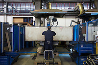 SOVERIA MANNELLI, ITALY - 16 NOVEMBER 2016: A worker assembles a chair in the warehouse of Camillo Sirianni, a school furniture manifacturer in Soveria Mannelli, Italy, on November 16th 2016.<br /> <br /> Camillo Sirianni is a third generation family business that started as a family mechanized carpentry in 1909 and transformed into a leading school furniture manufacturer. In a high-tech warehouse in the outskirts of Soveria Mannelli, they assemble thousands of Calabrian beechwooden, colorful desks, benches, closets and other accessories that are later shipped to many corners of the globe, from the United Kingdom to the Emirates, from central America to Polynesia.<br /> <br /> Soveria Mannelli is a mountain-top village in the southern region of Calabria that counts 3,070 inhabitants. The town was a strategic outpost until the 1970s, when the main artery road from Naples area to Italy's south-western tip, Reggio Calabria went through the town. But once the government started building a motorway miles away, it was cut out from the fastest communications and from the most ambitious plans to develop Italy's South. Instead of despairing, residents benefited of the geographical disadvantage to keep away the mafia infiltrations, and started creating solid businesses thanks to its administrative stability, its forward-thinking mayors and a vibrant entrepreneurship numbering a national, medium-sized publishing house, a leading school furniture manufacturer and an ancient woolen mill.