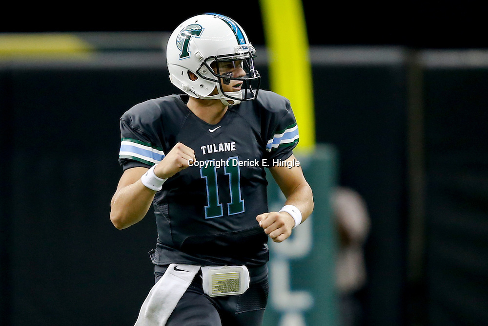 Aug 29, 2013; New Orleans, LA, USA; Tulane Green Wave quarterback Nick Montana (11) celebrates after a 49 yard completion to wide receiver Ryan Grant (not pictured) during the first quarter against the Jackson State Tigers at the Mercedes-Benz Superdome. Mandatory Credit: Derick E. Hingle-USA TODAY Sports