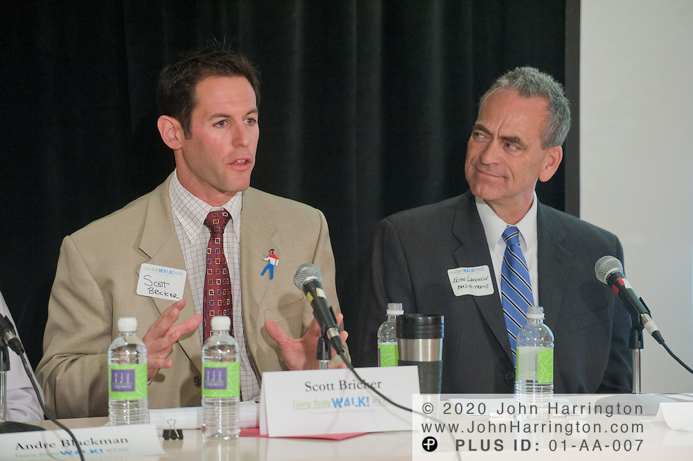 Scott Bricker (L), Executive Director, America Walks speaks during a panel discussion at the Walking Summit as Keith Laughlin (R), President of Rails-to-Trails Conservancy looks on at the Center for Total Health in Washington, DC on September 20th, 2011. Kaiser Permanente advocated their Every Body Walk Campaign by bringing leaders and health experts to discuss the healthy benefits of incorporating walking into a daily routine.