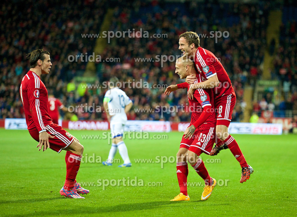 13.10.2014, City Stadium, Cardiff, WAL, UEFA Euro Qualifikation, Wales vs Zypern, Gruppe B, im Bild Wales' David Cotterill celebrates scoring the first goal against Cyprus with team-mate Andy King and Gareth Bale // 15054000 during the UEFA EURO 2016 Qualifier group B match between Wales and Cyprus at the City Stadium in Cardiff, Wales on 2014/10/13. EXPA Pictures &copy; 2014, PhotoCredit: EXPA/ Propagandaphoto/ David Rawcliffe<br /> <br /> *****ATTENTION - OUT of ENG, GBR*****