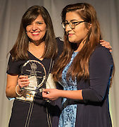 Aleida Rios, left, is presented a distinguished alumni award by Tabitha Cerda during the State of the Schools luncheon at the Hilton of the Americas, February 15, 2017.