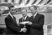 25/03/1966<br /> 03/25/1966<br /> 25 March 1966<br /> Córas Tráchtála award in Irish Boat show.  At the Irish Boat Show organised by the Irish Yachting Association at the RDS, Ballsbridge, Dublin Mr John Haughey, Chairman, Córas Tráchtála presented a silver bowl as a perpetual award for the best professionally built and finished boat in the Show. Picture shows Mr. John Haughey (right) presenting the award to Mr Edward C. Magee, Managing Director, Hickey Boats Ltd., Galway Bay, Ireland, who won first place with a 26ft long 4-berth sea-going cabin cruiser, Venturer Class, Margarita. In the centre is Mr John Walker, Honorary Secretary Irish Boat Show Committee.