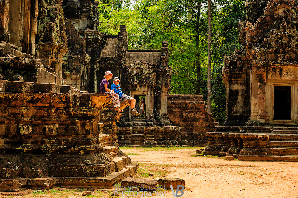 two kids relaxing at Thommanon temple, Siem Reap, Cambodia