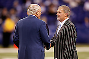 Indianapolis Colts Owner and CEO Jim Irsay (right) shakes hands with Houston Texans Founder, Chairman and Chief Executive Officer Robert McNair during the NFL week 8 football game against the Houston Texans on Monday, November 1, 2010 in Indianapolis, Indiana. The Colts won the game 30-17. ©Paul Anthony Spinelli