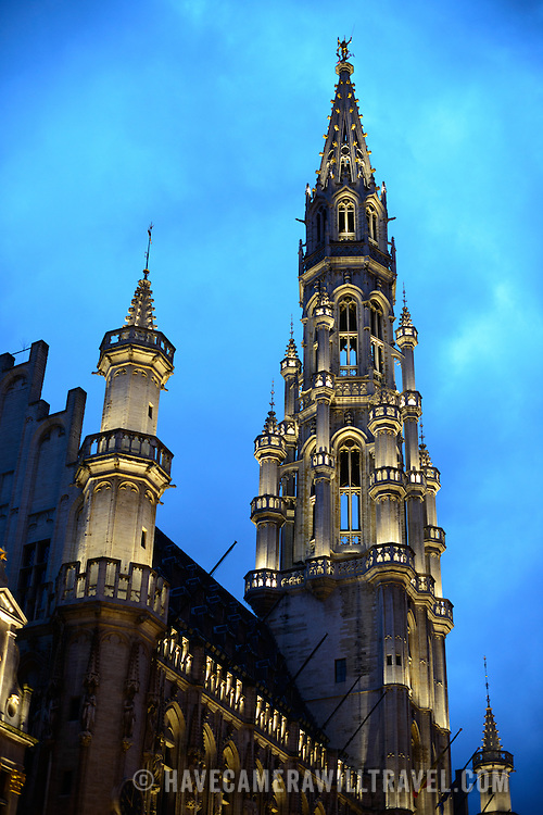 Central spire of the Town Hall (Hotel de Ville) in the Grand Place, Brussels. Originally the city's central market place, the Grand-Place is now a UNESCO World Heritage site. Ornate buildings line the square, including guildhalls, the Brussels Town Hall, and the Breadhouse, and seven cobbelstone streets feed into it.