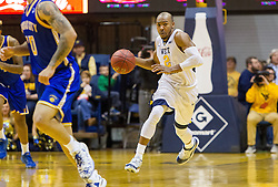 Dec 17, 2016; Morgantown, WV, USA; West Virginia Mountaineers guard Jevon Carter (2) dribbles the ball up the floor during the second half against the UMKC Kangaroos at WVU Coliseum. Mandatory Credit: Ben Queen-USA TODAY Sports