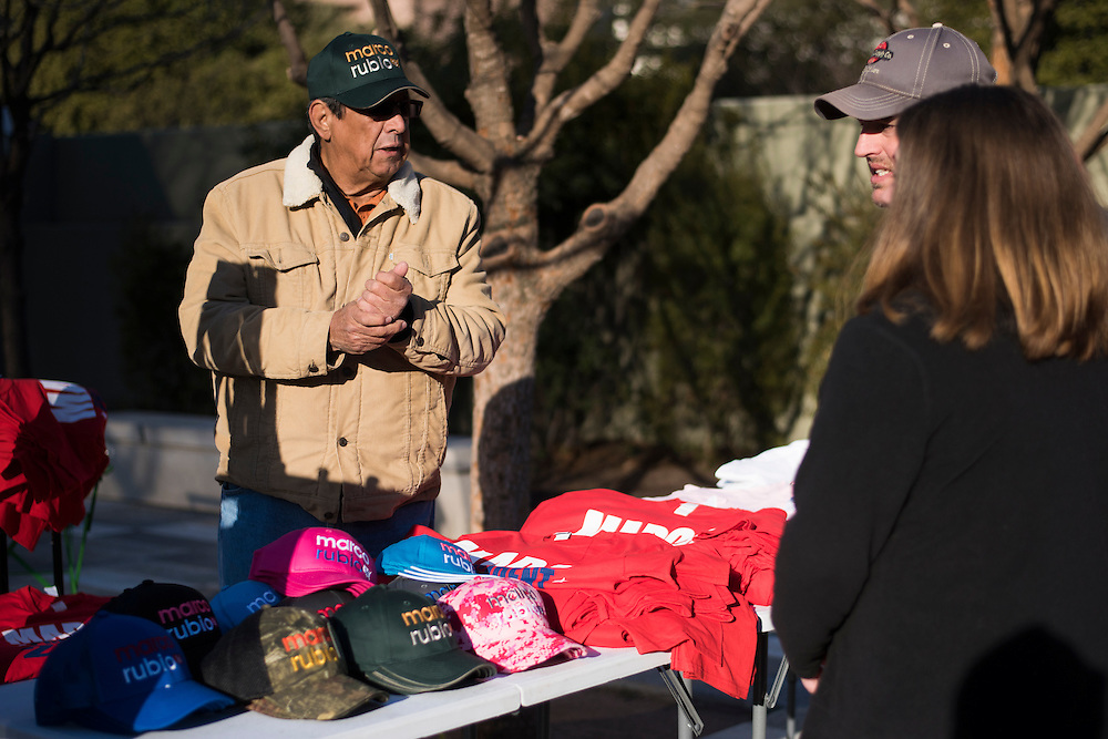 Tito Medina sells memorabilia outside a campaign rally for Senator Marco Rubio on February 26, 2016 in Dallas, Texas.  (Cooper Neill for The New York Times)