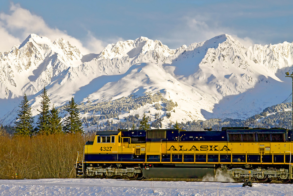 Alaska. Winter view of the Alaska Railroad in Seward with mountains in the Chugach National Forest in the background.