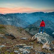 Heather Goodrich looks out on hazy wildfire smoke infested sunset over Beartooth Pass.