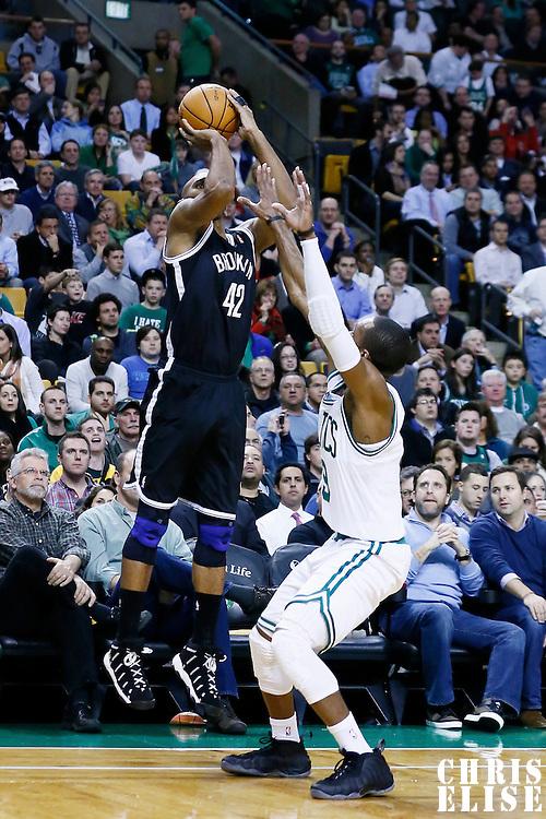 28 November 2012: Brooklyn Nets small forward Jerry Stackhouse (42) takes a three point jumpshot over Boston Celtics point guard Rajon Rondo (9) during the Brooklyn Nets 95-83 victory over the Boston Celtics at the TD Garden, Boston, Massachusetts, USA.