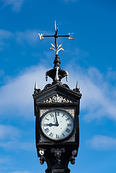 Detail of clock in Ullapool on the North Coast 500 tourist motoring route in northern Scotland, UK