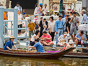 12 FEBRUARY 2015 - BANGKOK, THAILAND:  Customers on shore buy food from vendors in canoes on a new floating market opened in Khlong Phadung Krung Kasem, a 5.5 kilometre long canal dug as a moat around Bangkok in the 1850s. The floating market opened at the north end of the canal near Government House, which is the office of the Prime Minister. The floating market was the idea of Thai Prime Minister General Prayuth Chan-ocha. The market will be open until March 1.   PHOTO BY JACK KURTZ