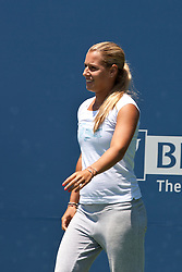 July 30, 2011; Stanford, CA, USA;  Dominka Cibulkova (SVK) enters the court to address the crowd after retiring from the match against Marion Bartoli (FRA), not pictured, during the semifinals of the Bank of the West Classic women's tennis tournament at the Taube Family Tennis Stadium.