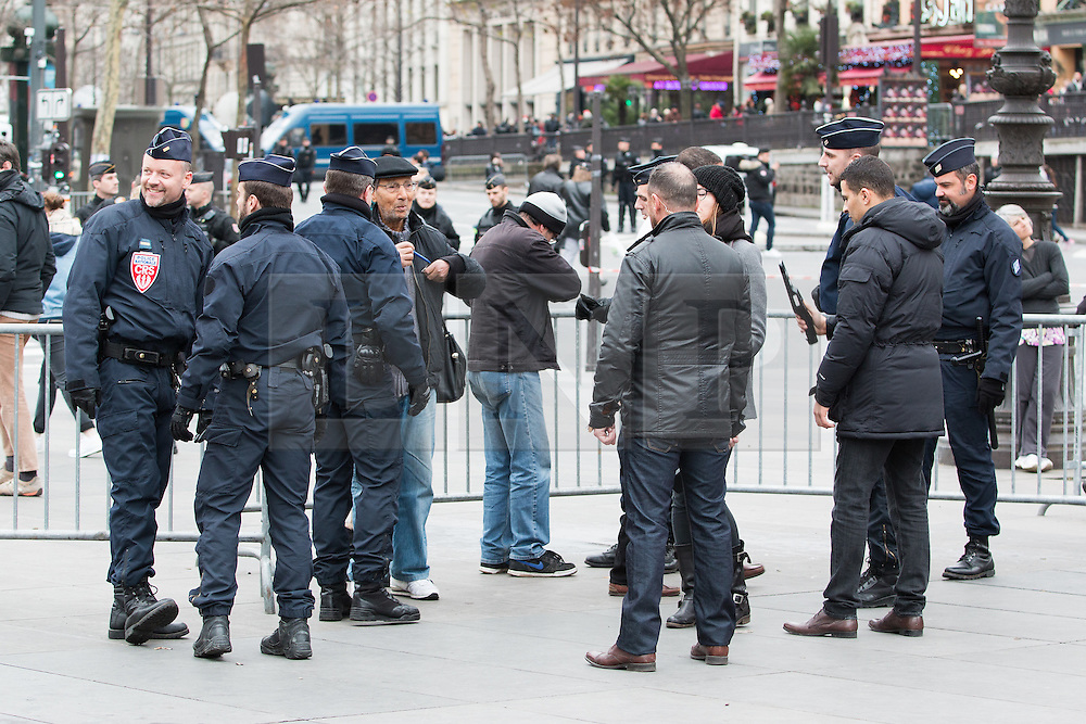 © Licensed to London News Pictures. 10/01/2016. France, Paris. Members of the public are searched before allowed entry in to the enclosure on place de la Republique for the official ceremony in remembrance of the Charie Hebdo killings in 2015. Today January 10th 2016. Photo credit: Hugo Michiels/LNP