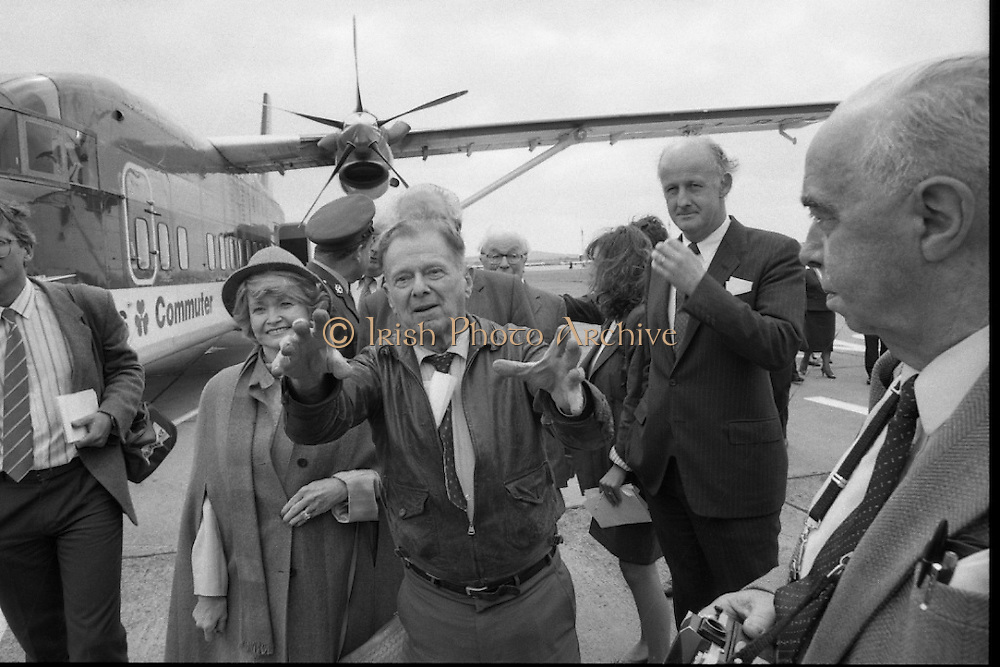 """""""Wrongway Corrigan"""" at Baldonnell.  (R84)..1988..18.07.1988..07.18.1988..18th July 1988..Douglas """"Wrongway"""" Corrigan returned to Baldonnell Airdrome 50 years after his transatlantic flight in a Curtiss Robin aircraft. After a transcontinental flight from California to New York, Mr Corrigan was to make a return flight to California. However on take off he took off over the Atlantic to Ireland. He had been refused permission from American authorities to fly solo to Ireland. On Arrival in Ireland he maintained that bad weather conditions and compass malfunction were the reason for his """"wrongway' flight..In 1938 he was met by Mr R W O'Sullivan as he disembarked from his plane..Comdt D K Johnston, Irish Air Corps flew in formation with Mr Corrigan in Irish Airspace..Mr J Maher,Aer Lingus Chief Engineer,hangared the aircraft on arrival and Mr V Ellis of Oriole Steamship Lines was responsible for the transportation of the aircraft back to the U.S. aboard the S S Lehigh.  These gentlemen were here today to meet again with Mr Corrigan...Mr Corrigan describes his original flight to members of the media."""
