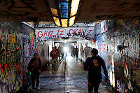 Students walk in the free expression tunnel at NC State. Photo by Marc Hall
