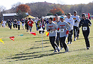 Sierra Kome (from left) and Angela Allsop both of Burlington turn the corner at the Muddy Monster Cross Country Run at Seminole Valley Park in Cedar Rapids on Saturday October 24, 2009. Over 500 people were registered for the event which featured a 5K run/walk, a 15K run, a 1 mile run for kids 17 and under, and a kids fun run. Proceeds from the event benefit The Achilles Heel Foundation.