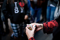 Cynthia Yee plays a card trick for her group, in San Francisco, Ca., on Friday, June 18, 2010.