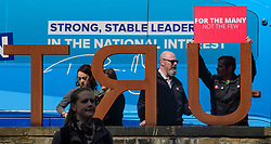 © Licensed to London News Pictures. 18/05/2017. Halifax, UK.  A group of Labour Party supports stage a demonstration outside the venue for the launch event for the Conservative Party manifesto at The Arches in Halifax, West Yorkshire. The Conservatives are the last of the three main parties to launch their manifesto ahead of a snap general election called for June 8, 2017. Photo credit: Ben Cawthra/LNP