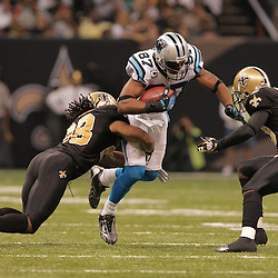 2008 December, 28: New Orleans Saints defenders Usama Young (28) and Randall Gay (20) combine to tackle Carolina Panthers wide receiver Muhsin Muhammad (87) during a week 17 game between NFC South divisional rivals the Carolina Panthers and the New Orleans Saints at the Louisiana Superdome in New Orleans, LA.