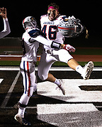 New Oxford's AJ Baadte (46) is lifted into the air by New Oxford's Wyatt Taughinbaugh (19) as they celebrate winning a game against South Western, Friday, Oct. 19, 2018, in Penn Township. The New Oxford Colonials beat the South Western Mustangs 21-14.