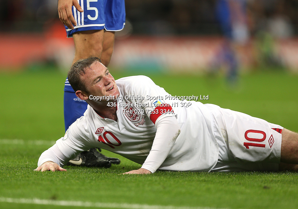 12 October 2012 Football. England v San Marino.<br /> Wayne Rooney manages a smile despite missing a chance.<br /> Photo: Mark Leech.