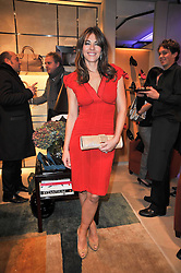ELIZABETH HURLEY at a party to launch the book 'Italian Touch' - A Celebration of Italian Lifestyle held at TOD's, 2-5 Old Bond Street, London on 4th November 2009.