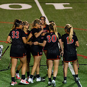 23 March 2018: San Diego State Aztecs midfielder Morgan Taylor is congratulated by teammates after scoring a goal in the second half to extend their lead to 6-4. The Aztecs beat the Lady Flames 11-10 Friday night. <br /> More game action at sdsuaztecphotos.com