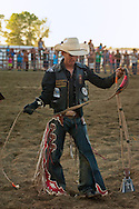 Crow Fair, Indian rodeo, Bull Rider, Justin Granger after successful ride, Montana, Navajo