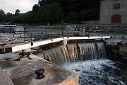 Ottawa locks at the juncture of Rideau Canal with Ottawa River in Ottawa, ON, Canada, August 2, 2009. The Rideau Canal (French: Canal Rideau), also known as the Rideau Waterway, connects the city of Ottawa, Ontario, Canada  on the Ottawa River to the city of Kingston, Ontario on Lake Ontario. The canal was opened in 1832 and is still in use today. The canal system uses sections of rivers and lakes in Eastern Ontario. It is the oldest continuously operated canal system in North America, and in 2007, it was registered as a UNESCO World Heritage Site. In winter, a section of the Rideau Canal passing through central Ottawa becomes officially the world's largest skating rink.