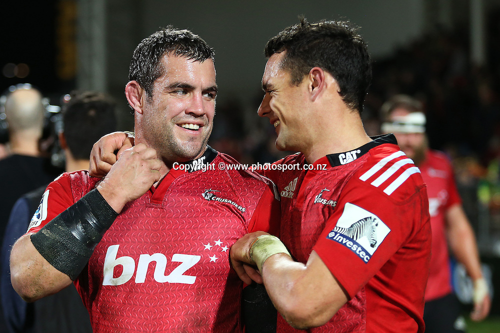 Corey Flynn of the Crusaders and Dan Carter following the Investec Super Rugby game between Crusaders v Highlanders at AMI Stadium, Christchurch. 12 July 2014 Photo: Joseph Johnson/www.photosport.co.nz