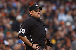June 22, 2011; San Francisco, CA, USA;  MLB umpire Andy Fletcher (49) stands behind home plate during the first inning between the San Francisco Giants and the Minnesota Twins at AT&T Park. San Francisco defeated Minnesota 5-1.