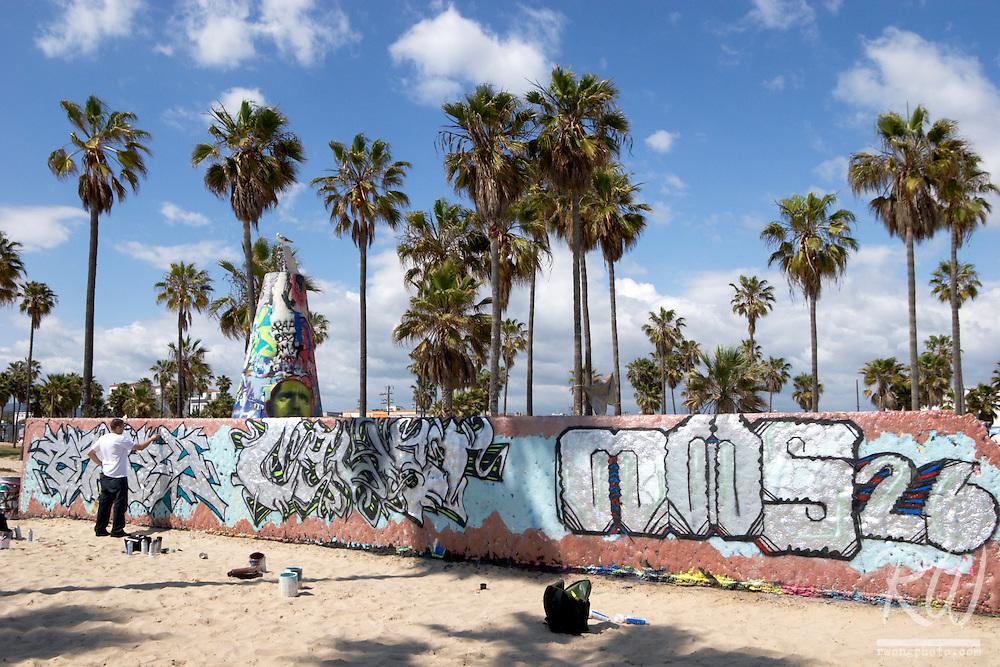 Graffiti Artist Spray Painting Wall, Venice Beach, California