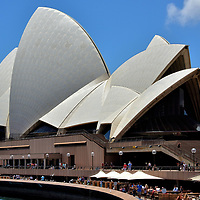 Iconic Sydney Opera House in Sydney, Australia<br /> The large concrete shells of the Sydney Opera House are as graceful and free flowing as the sailboats floating in the harbour. This landmark performing arts center opened in 1973 on Bennelong Point. The famous venue hosts the city&rsquo;s orchestra, theater, ballet and opera. It became iconic for the annual fireworks display watched on television by over a billion people who celebrate the coming of each new year.
