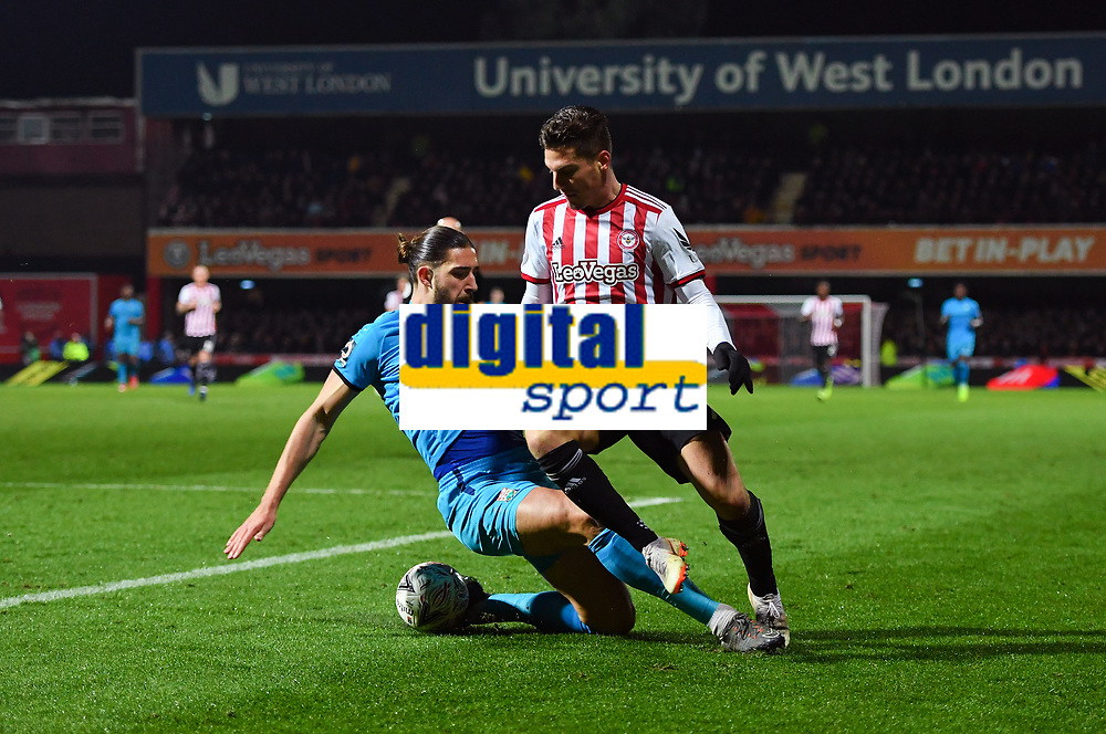 Football - 2018 / 2019 Emirates FA Cup - Fourth Round, Replay: Brentford vs. Barnet<br /> <br /> Brentford's Sergi Canos holds off the challenge from Barnet's Dan Sweeney, at Griffin Park.<br /> <br /> COLORSPORT/ASHLEY WESTERN