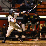 24 February 2018: The San Diego State Aztec baseball team competes in day two of the Tony Gwynn legacy tournament against #4 Arkansas. San Diego State Aztecs catcher Dean Nevarez (25) hits an rbi single to tie the game at 2-2 in the bottom of the sixth inning. The Aztecs dropped a close game to the Razorbacks 4-2. <br /> More game action at sdsuaztecphotos.com