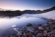 Dawn is viewed from a remote high unamed lake on the east side of the Gore Range above Silverthorne, Colorado.