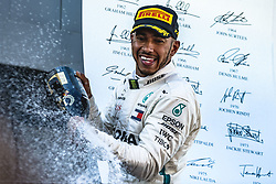 May 13, 2018 - Barcelona, Catalonia, Spain - LEWIS HAMILTON (GBR) of Mercedes sprays with champagne as he celebrates his victory of the Spanish GP holding his cup on the podium at the Circuit de Barcelona - Catalunya (Credit Image: © Matthias Oesterle via ZUMA Wire)