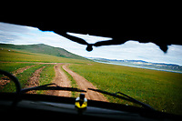 A dirt road leading into the wilds of northern Mongolia.