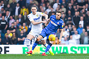 Luke Ayling of Leeds United (2) tries to get round Craig Noone of Bolton Wanderers (12) during the EFL Sky Bet Championship match between Leeds United and Bolton Wanderers at Elland Road, Leeds, England on 23 February 2019.